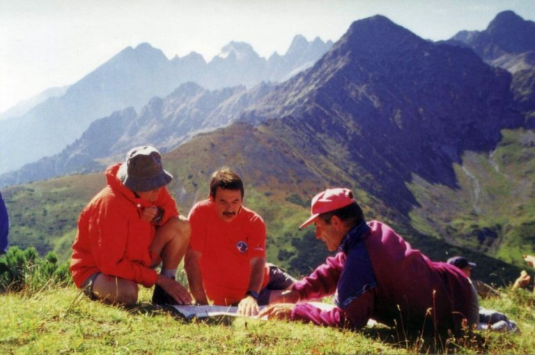High Tatras, mountain meadow, hikers studying map