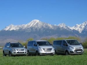 Rajec travel minivans with snowy High Tatras in the background
